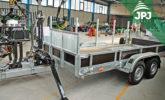 Silniční speciál JPJ Forest - přívěs Vezeko s hydraulickou rukou
